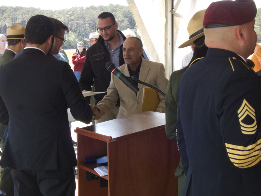 Receiving the certificate of citizenship.