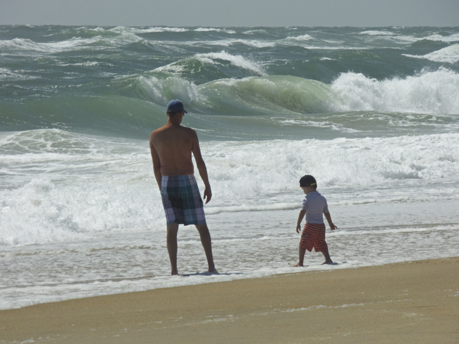Father and son not going in for a swim on a red flag day.
