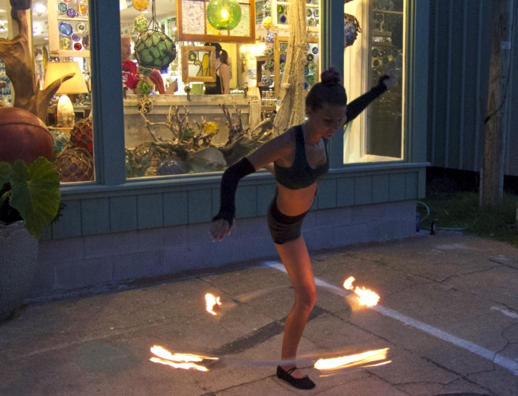 Flaming hula hoop performance in front of Seagreen Gallery.