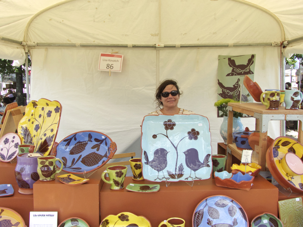 Lisa Kovac with her pottery on display at New World Festival of the Arts.