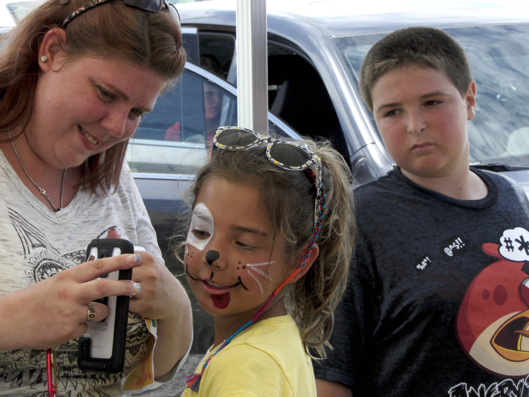 Face painting is one of the many activities that are part of the Kitty Hawk Kites Watermelon Festival.