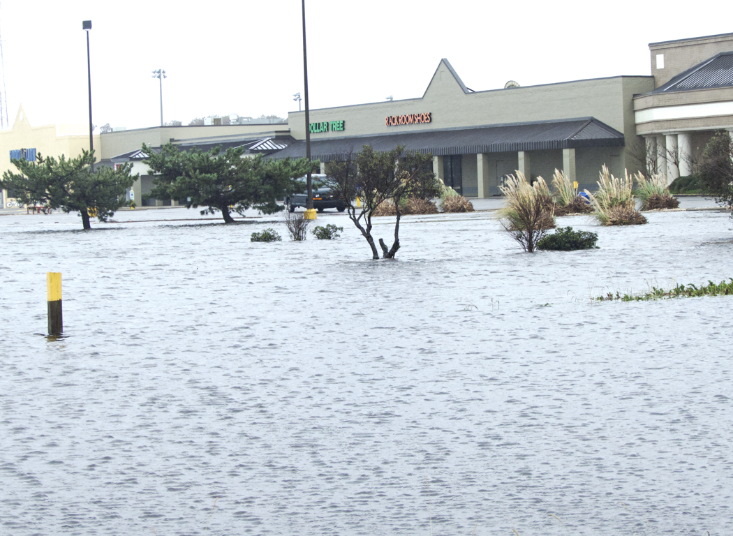 "Dare Center parking lot flooded. With 8"" of torrential rains in less than 24 hours, Outer Banks roads and parking lots experienced unprecedented flooding."