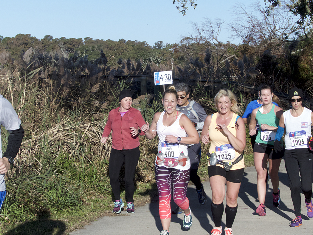 Marathoners on the multi-use path by Kitty Hawk Bay.