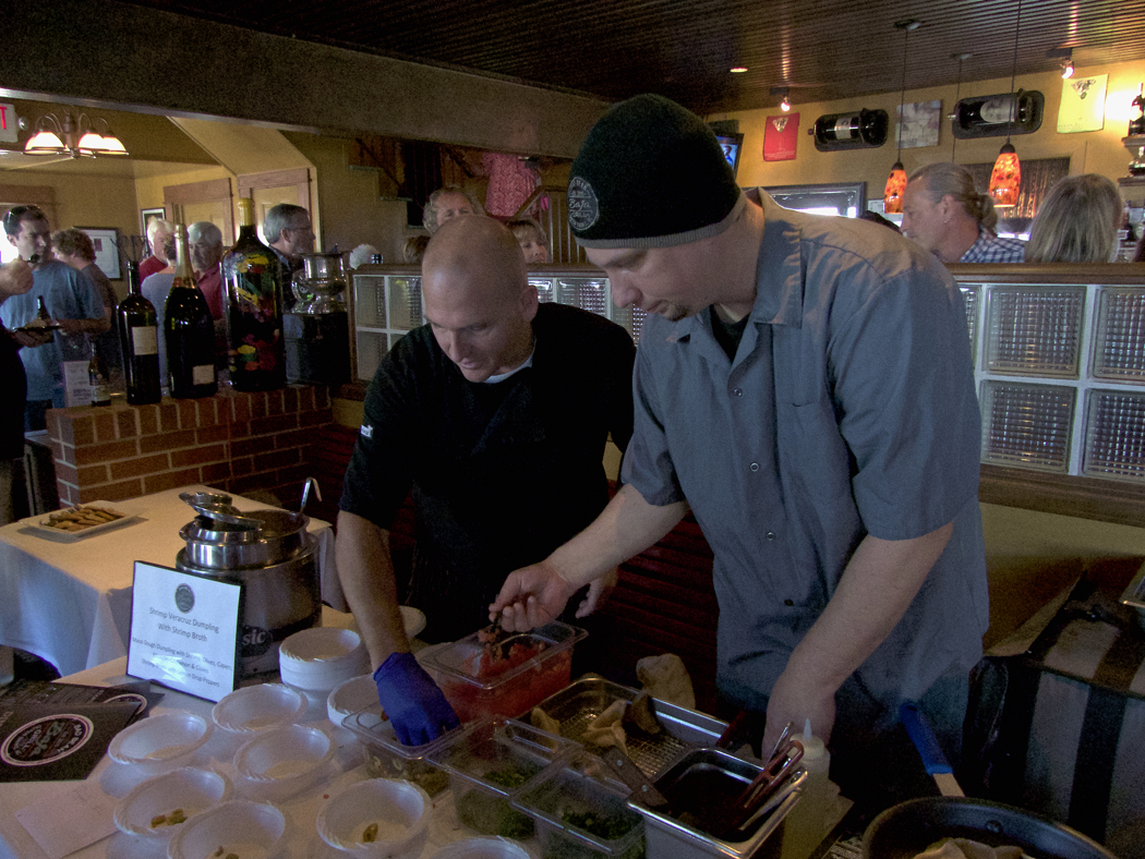 Rob Robinson in black and Matt Payne, chef's for Bad Bean in Kitty Hawk, just down the street from the Joe Lamb Jr., & Associates offices.