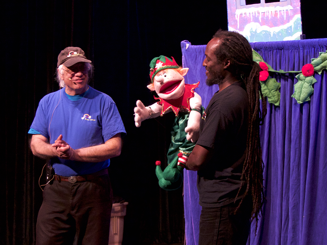 Tony Gabrielle (L) Christmas Elf (C) and James Cooper explaining how puppets work.