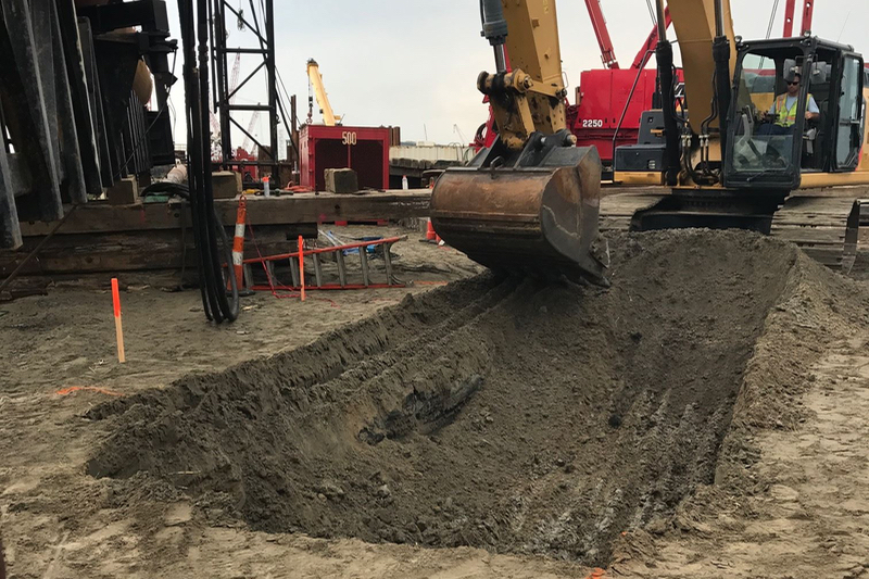 Digging for the severed cable at the south end of the Bonner Bridge construction zone. Photo, Outer Banks Voice.
