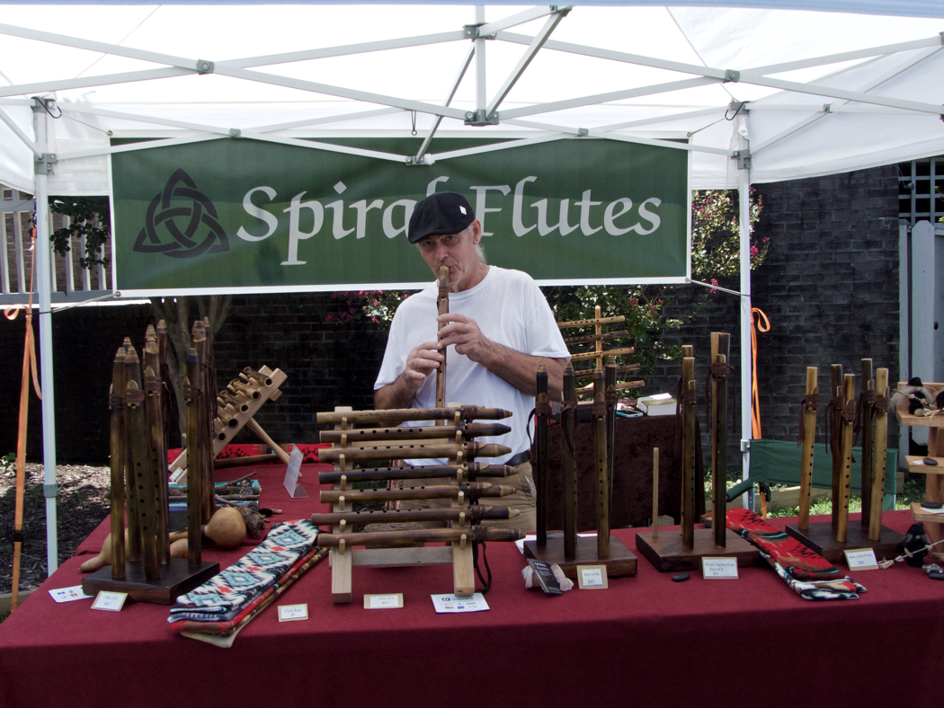 David Graves plays one of his spiral flutes at the Manteo New World Festival of the Arts.