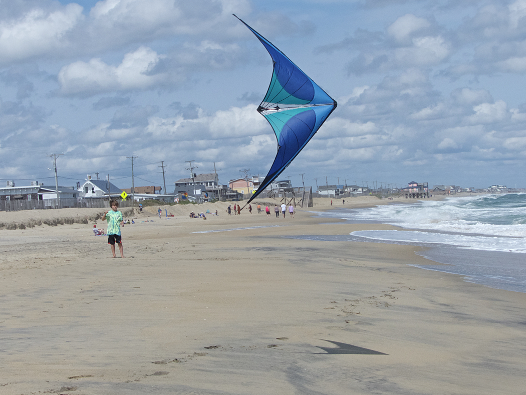 Gavin Carey showing his kite flying skills on the beach in Kitty Hawk.