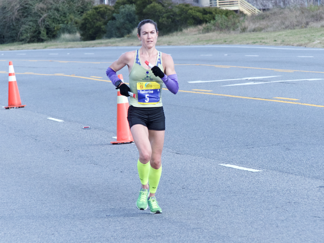 Katherine Price, winner of the 12th Annual Outer Banks Marathon leading all women as she passes Jockey's Ridge.