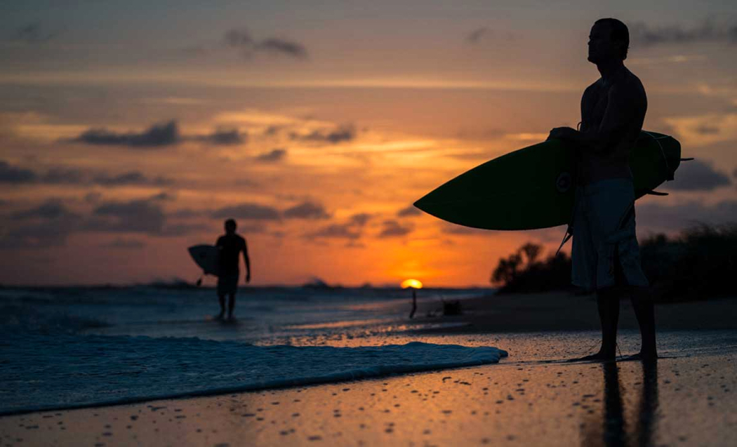 A Daniel Pullen image showing surfers at sunrise.