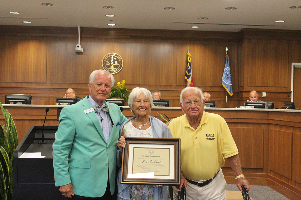 Chair of the Dare County Commissioners Bob Woodard presents Certificate of Appreciation to Ann and Joe Lamb.