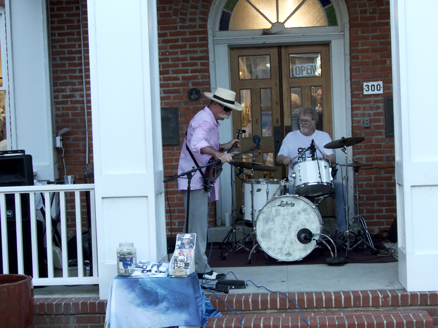 Mojo Collins performs at a First Friday on the DCAC Gallery steps.
