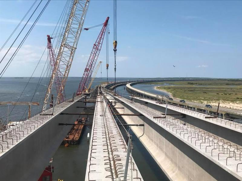 The last girder is place in the replacement span of the Bonner Bridge. Photo, WUNC