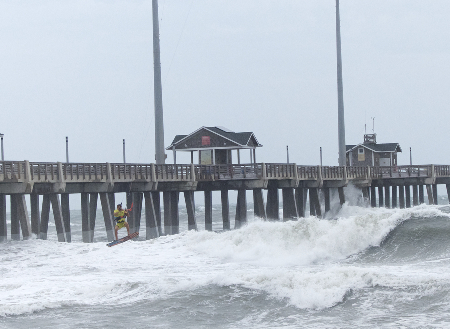 Dimitri Maramenides of Epic Kiteboarding  at Jennette's Pier on Friday. Although the Atlantic Ocean was extremely rough, there was no reported damage along the northern Outer Banks.