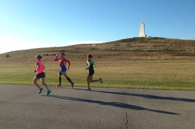 Outer Banks Marathon runners passing the Wright Brothers Monument.