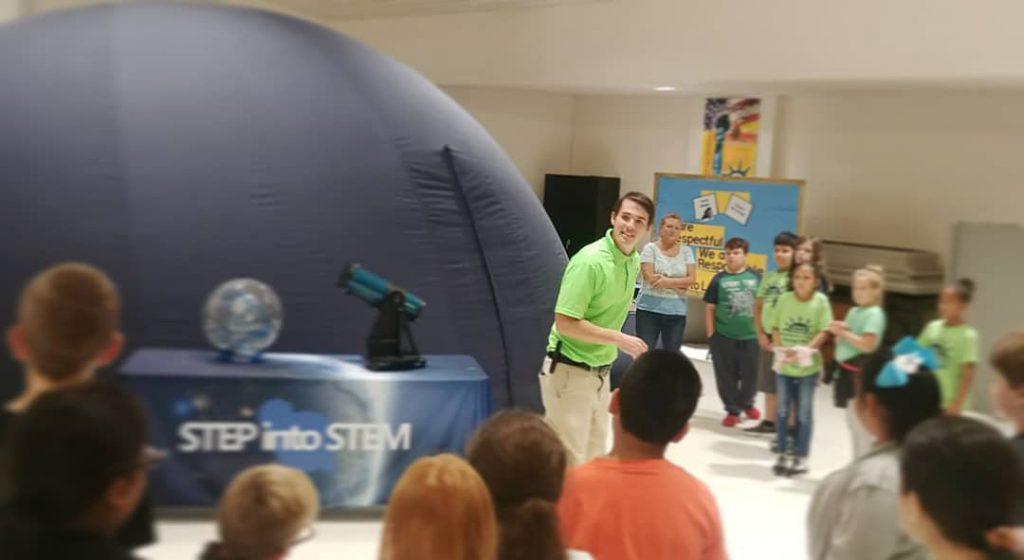 Brian Baker, A Time for Science Astronomy and Space Science Director, showcasing the portable planetarium at a school outreach event. Photo Credit: A Time for Science