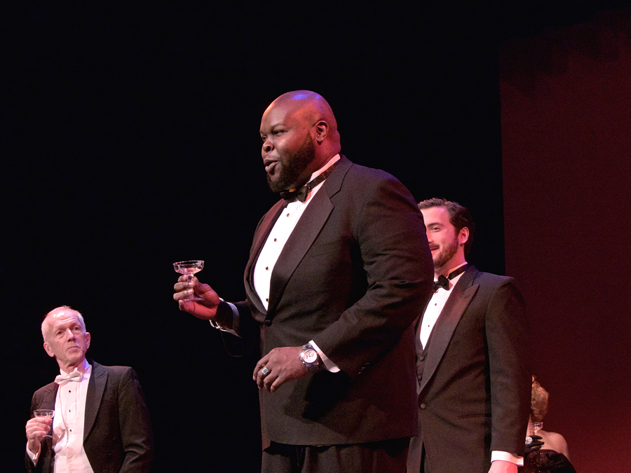 Tshombe Selby as Alfredo proposing a toast to true love.