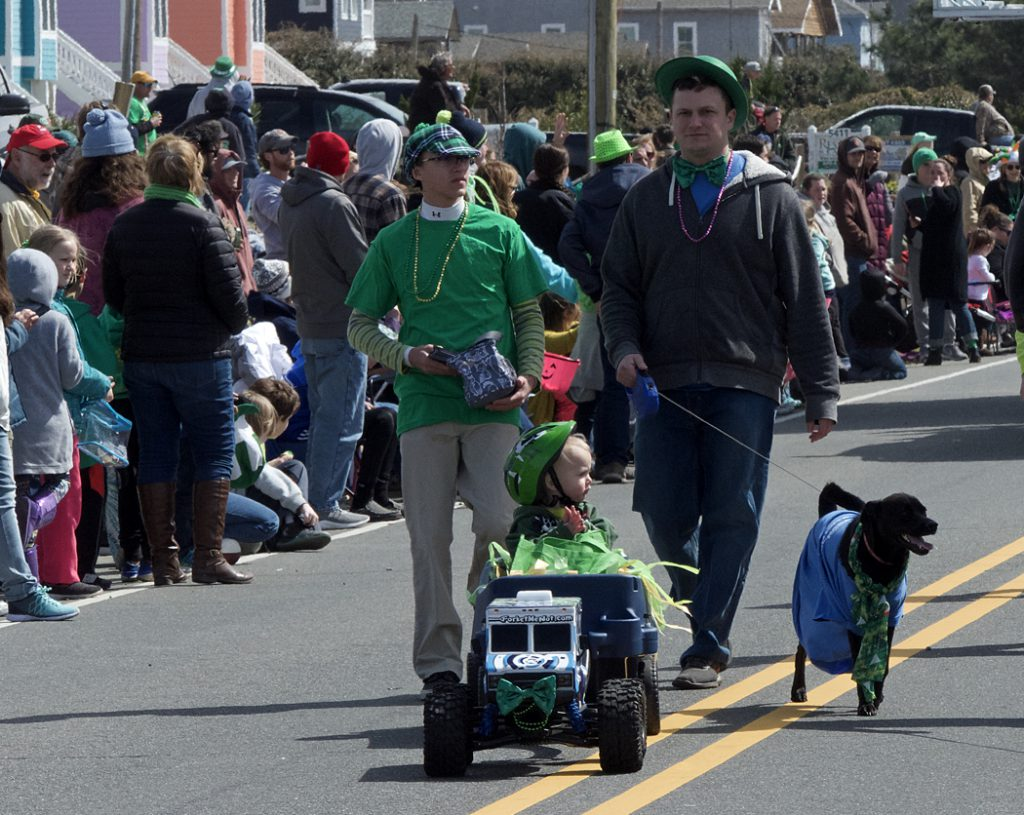 An RC truck tows it's passenger at the 30th Annual Kelly's St. Patrick's Day Parade.