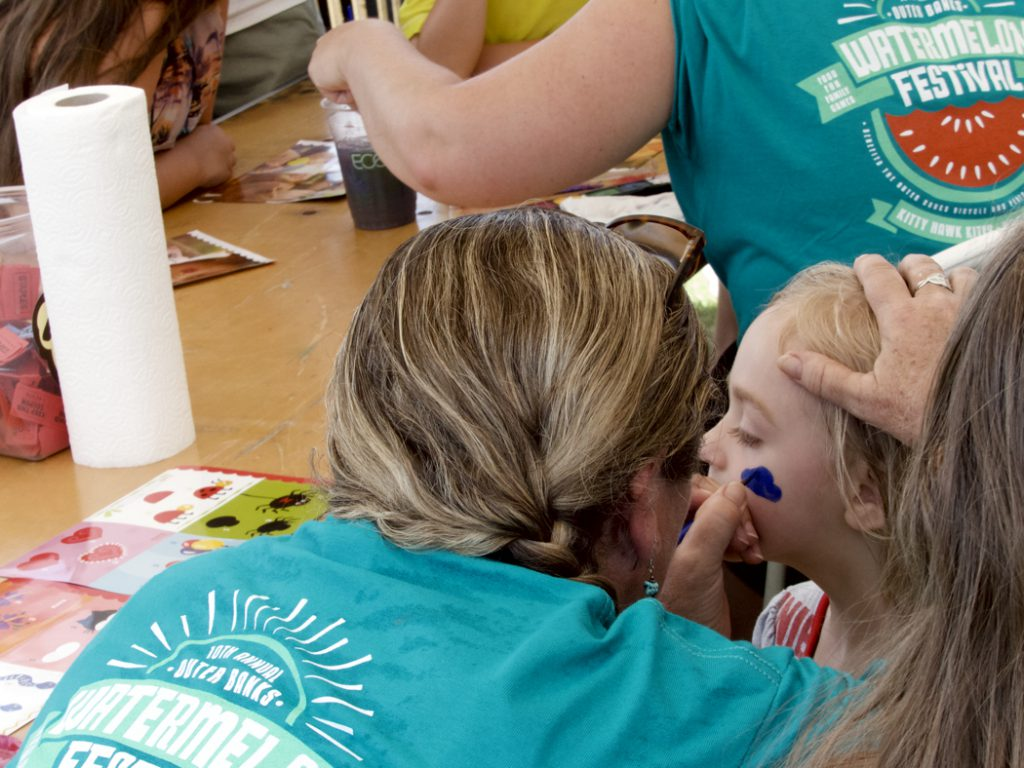 Face painting is just one of the great kid-friendly activities at the Kitty Hawk Kites Watermelon Festival.