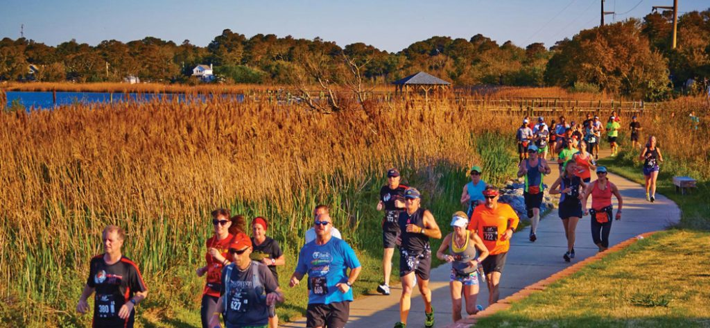 Marathon runners pass Kitty Hawk Bay in Kitty Hawk.