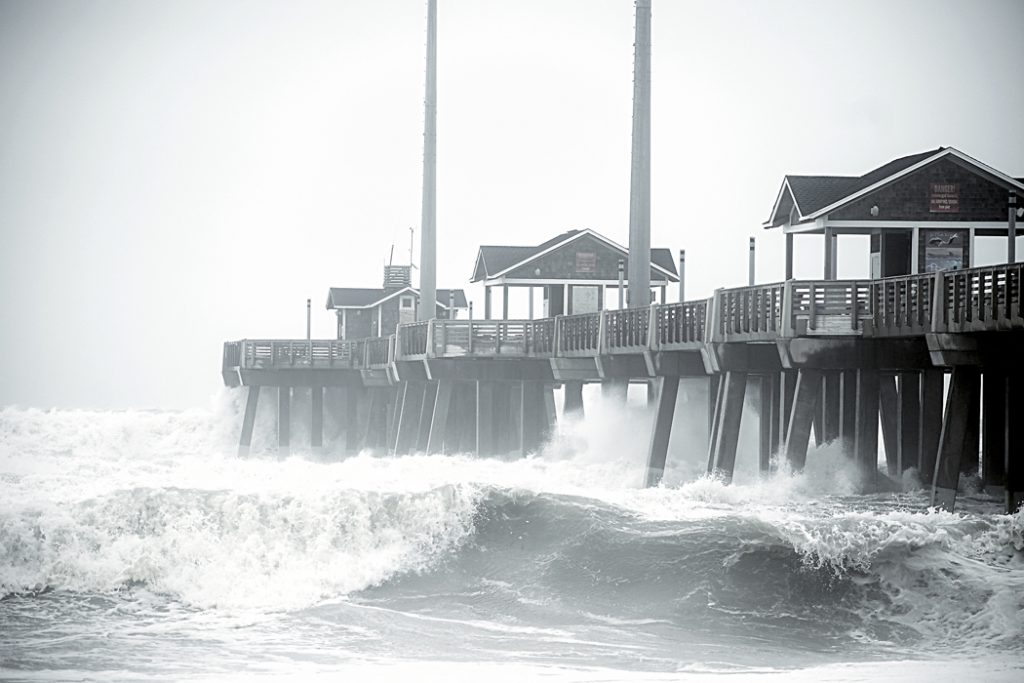 Waves top the railing at Jennette's Pier on Sunday 11/17.