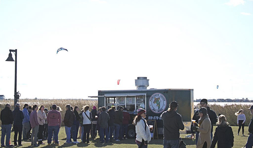A good sized crowd for the Fall Food Truck Showdown at the Nags Head Event Site, and kiteboarders riding the wind on Roanoke Sound.