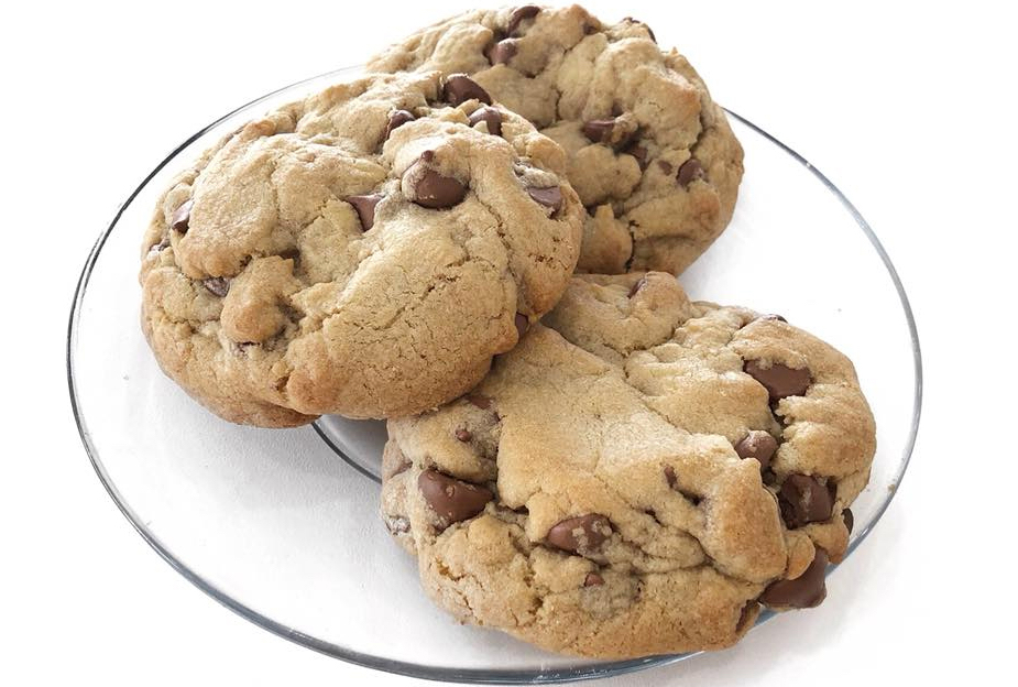A plate of Crumbl chocolate chip cookies.