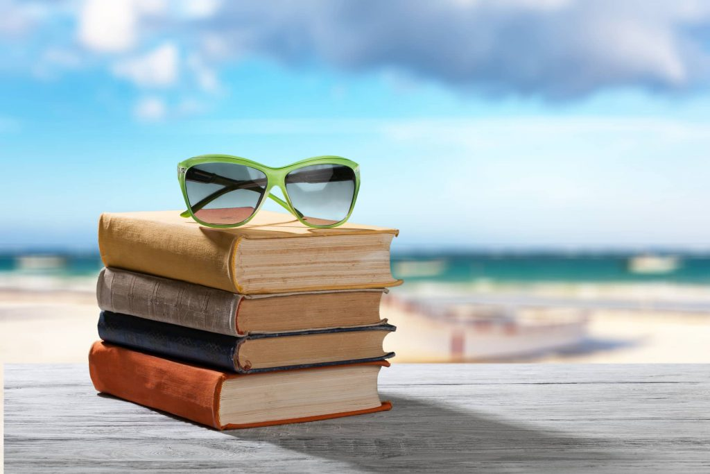 A stack of books to read on your next OBX Vacation.