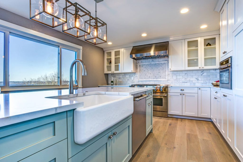 A fully equipped Outer Banks Vacation rental kitchen with a view of the ocean.