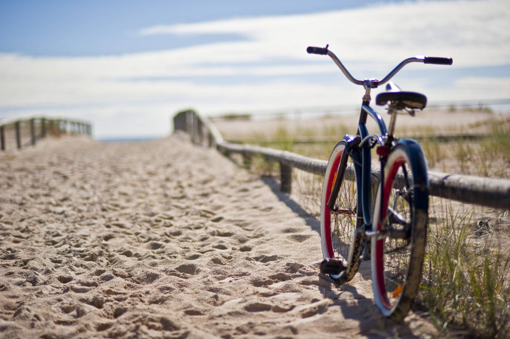 bike propped up at the beach