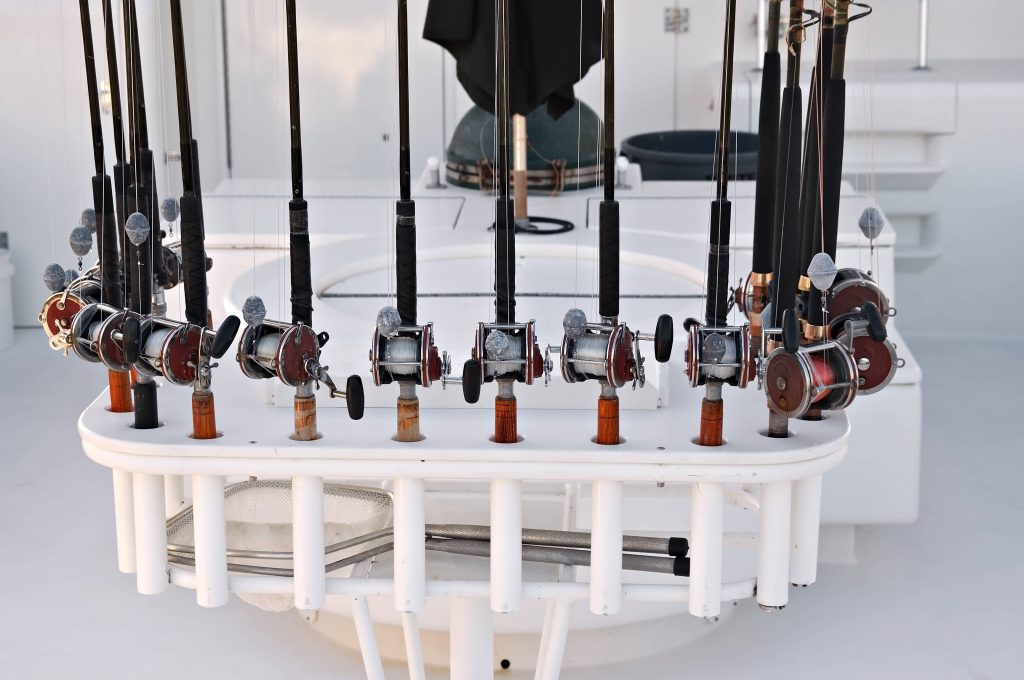A rack of fishing rods on a charter boat